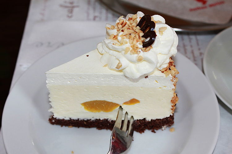Cream cheese is a must for cheese cakes and many similar pies and slices. It pairs well with the acidity of fruit.