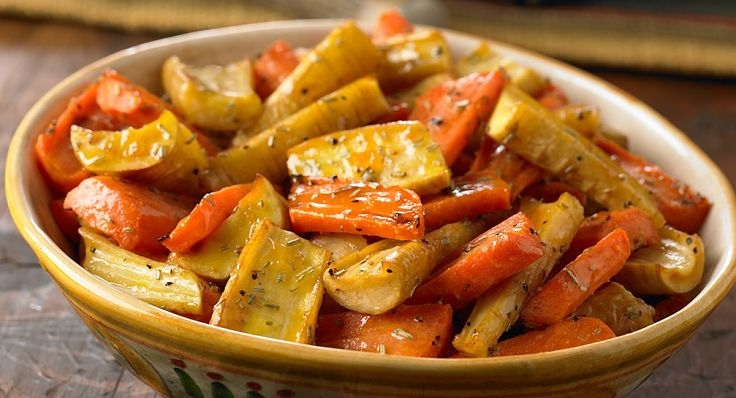 Parsnips pair well with carrots offering contrasting color, texture and tastes. Rosemary and other herbs enhance teh flavors.