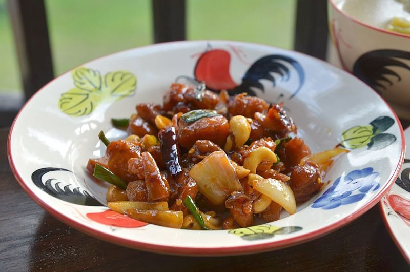 Thai Kung Pao chicken, fried with whole dried chillies and with tamarind in the sauce