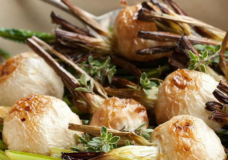 Roasted Japanese style whole turnips with their green tops fried in balsamic vinegar